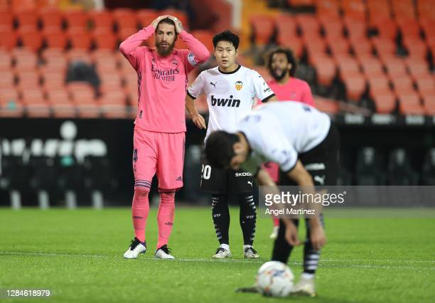 Sergio Ramos of Real Madrid reacts as Carlos Soler of Valencia prepares to take his third penalty during the La Liga Santander match between Valencia...
