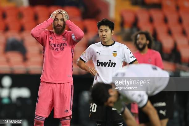 Sergio Ramos of Real Madrid reacts as Carlos Soler of Valencia prepares to take his third penalty during the La Liga Santander match between Valencia...
