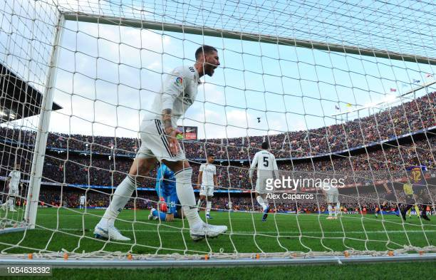 Sergio Ramos of Real Madrid reacts as Philippe Coutinho of Barcelona scores his sides first goal during the La Liga match between FC Barcelona and...