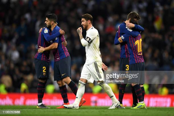 Sergio Ramos of Real Madrid reacts to defeat as he walks past celebrating Barcelona players after the full time whistle in the La Liga match between...