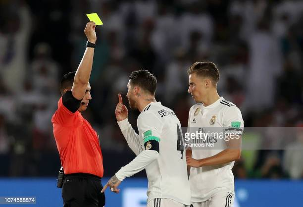 Sergio Ramos of Real Madrid receives a yellow card during the FIFA Club World Cup UAE 2018 Final between Al Ain and Real Madrid at the Zayed Sports...