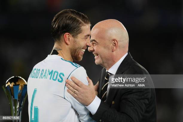 Sergio Ramos of Real Madrid receives his winners medal from FIFA President Gianni Infantino at the end of the FIFA Club World Cup UAE 2017 final...