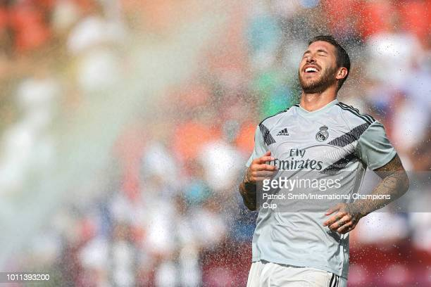 Sergio Ramos of Real Madrid runs through a sprinkler prior to the International Champions Cup at FedExField on August 4 2018 in Landover Maryland