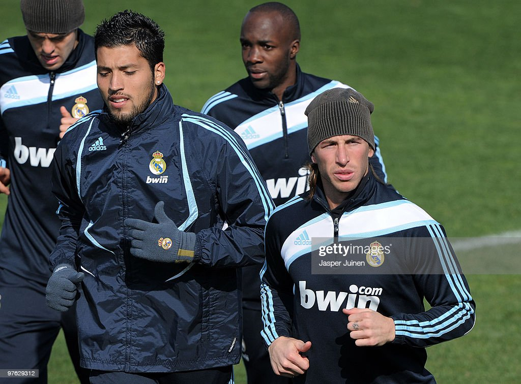 Sergio Ramos (R) of Real Madrid runs with his teammates during a training session, the day after Real Madrid's UEFA Champions League aggregate defeat against Lyon, at Valdebebas training ground on March 11, 2010 in Madrid, Spain.