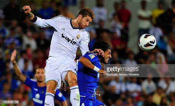 Sergio Ramos of Real Madrid saves on a header from Miguel Torres of Getafe during the la Liga match between Getafe and Real Madrid at Coliseum...