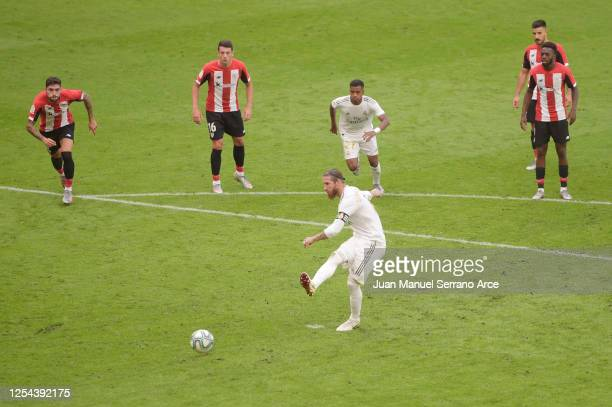 Sergio Ramos of Real Madrid scores a penalty for his team's first goal during the La Liga match between Athletic Club and Real Madrid CF at San Mames...