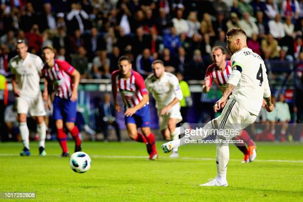 Sergio Ramos of Real Madrid scores his sides second goal from the penalty spot during the UEFA Super Cup between Real Madrid and Atletico Madrid at...
