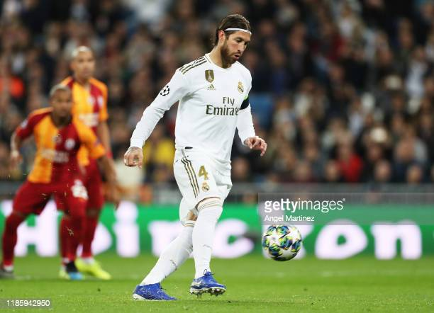 Sergio Ramos of Real Madrid scores his sides third from the penalty spot during the UEFA Champions League group A match between Real Madrid and...