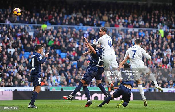 Sergio Ramos of Real Madrid scores his team's 1st goal during the La Liga match between Real Madrid CF and Malaga CF at the Bernabeu on January 21...