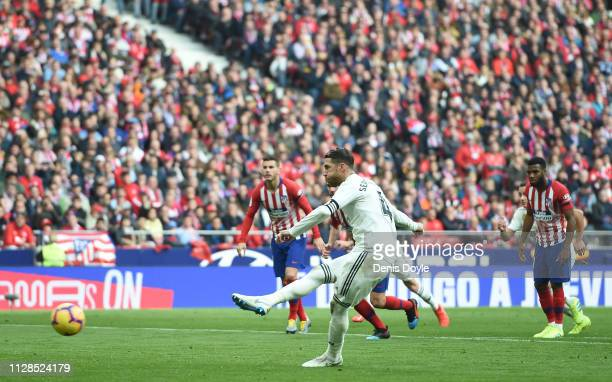 Sergio Ramos of Real Madrid scores his team's 2nd goal from the penalty spot during the La Liga match between Club Atletico de Madrid and Real Madrid...