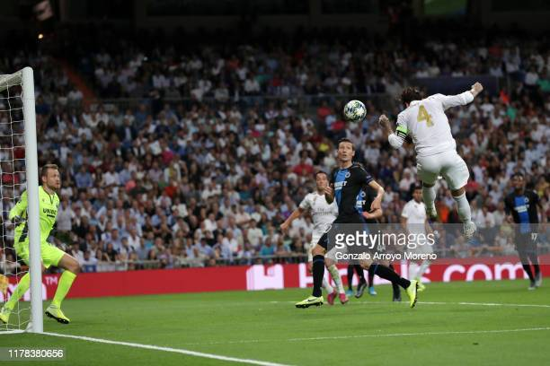 Sergio Ramos of Real Madrid scores his team's first goal during the UEFA Champions League group A match between Real Madrid and Club Brugge KV at...