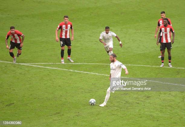 Sergio Ramos of Real Madrid scores his team's first goal from the penalty spot during the La Liga match between Athletic Club and Real Madrid CF at...