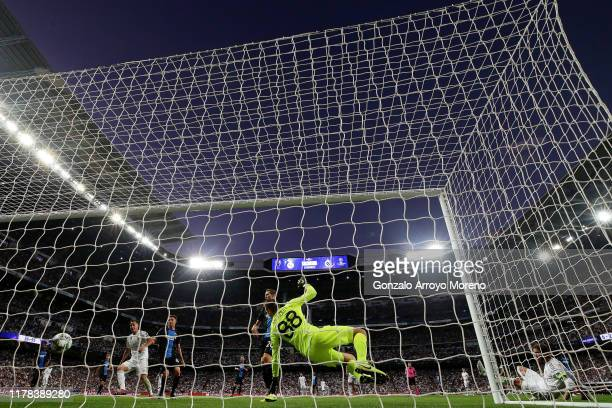 Sergio Ramos of Real Madrid scores his team's first goal past Simon Mignolet of Club Brugge during the UEFA Champions League group A match between...