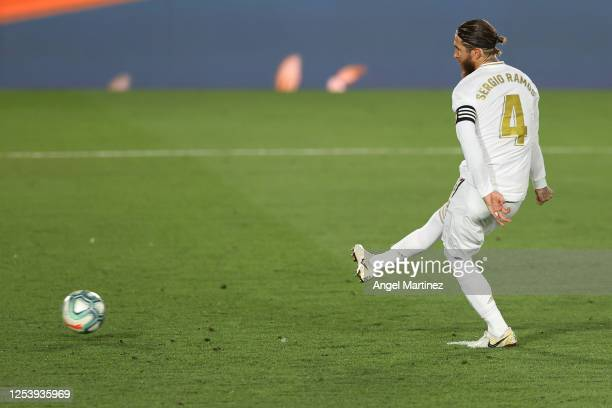 Sergio Ramos of Real Madrid scores his team's first goal with a penalty during the Liga match between Real Madrid CF and Getafe CF at Estadio Alfredo...