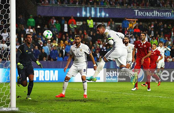 Sergio Ramos of Real Madrid scores his team's second goal during the UEFA Super Cup match between Real Madrid and Sevilla at Lerkendal Stadion on...
