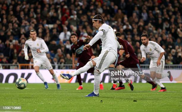 Sergio Ramos of Real Madrid scores his team's second goal from a penalty during the La Liga match between Real Madrid CF and RC Celta de Vigo at...