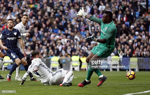 Sergio Ramos of Real Madrid scores his team's second goal past Carlos Kameni of Malaga CF during the La Liga match between Real Madrid and Malaga CF...