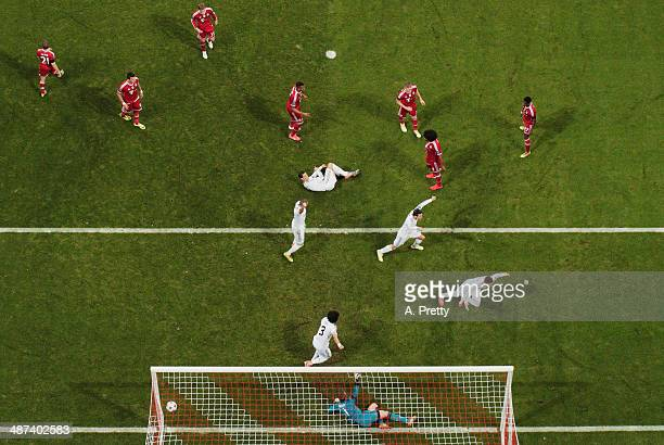 Sergio Ramos of Real Madrid scores the first goal during the UEFA Champions League semifinal second leg match between FC Bayern Muenchen and Real...