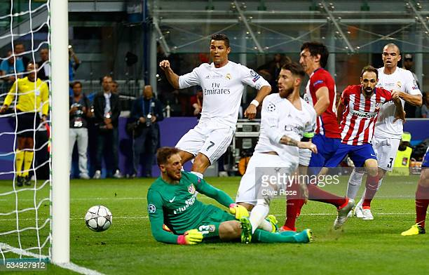 Sergio Ramos of Real Madrid scores the opening goal during the UEFA Champions League Final match between Real Madrid and Club Atletico de Madrid at...