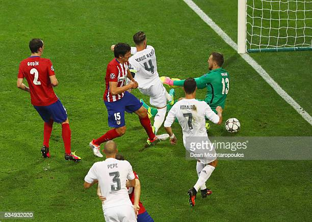 Sergio Ramos of Real Madrid scores the opening goal past Jan Oblak goalkeeper of Atletico Madrid during the UEFA Champions League Final match between...