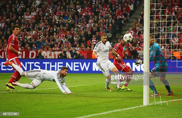 Sergio Ramos of Real Madrid scores their second goal with a header past goalkeeper Manuel Neuer of Bayern Muenchen during the UEFA Champions League...