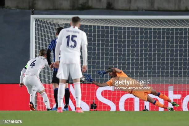 Sergio Ramos of Real Madrid scores their side's second goal from the penalty spot passed Marco Sportiello of Atalanta B.C during the UEFA Champions...