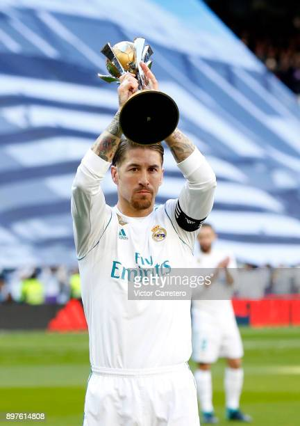 Sergio Ramos of Real Madrid shows the FIFA Club World Cup 2017 trophy before the La Liga match between Real Madrid and Barcelona at Estadio Santiago...