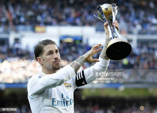 Sergio Ramos of Real Madrid shows the FIFA Club World Cup trophy before the La Liga match between Real Madrid and Barcelona at Estadio Santiago...