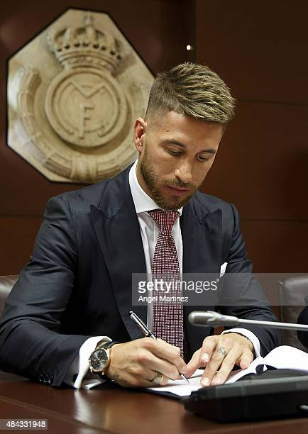 Sergio Ramos of Real Madrid signs his new fiveyear contract with Real Madrid at the Santiago Bernabeu stadium on August 17 2015 in Madrid Spain