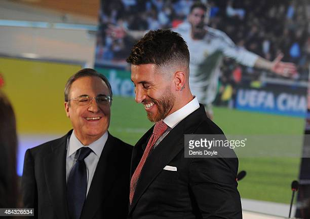 Sergio Ramos of Real Madrid smiles along with Real president Florentino Perez during a press conference to announce Ramos' new fiveyear contract with...