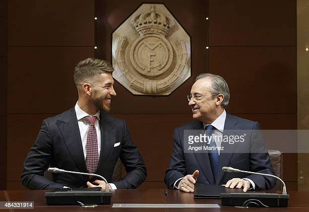 Sergio Ramos of Real Madrid smiles at Real president Florentino Perez before to announce Ramos' new fiveyear contract with Real Madrid at the...