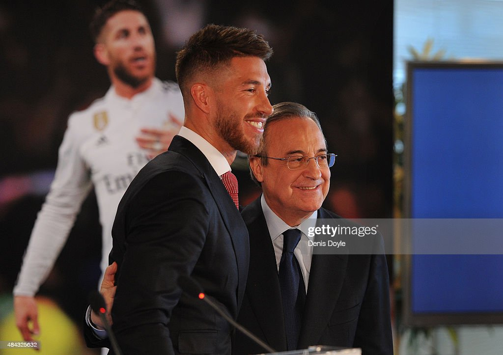 Sergio Ramos of Real Madrid smiles next to Real president Florentino Perez during a press conference to announce Ramos' new five-year contract with Real Madrid at the Santiago Bernabeu stadium on August 17, 2015 in Madrid, Spain.