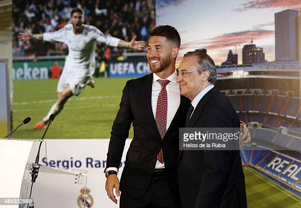 Sergio Ramos of Real Madrid smiles next to Real president Florentino Perez during a press conference to announce Ramos' new fiveyear contract with...