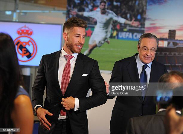 Sergio Ramos of Real Madrid stands with Real president Florentino Perez during a press conference to announce Ramos' new fiveyear contract with Real...