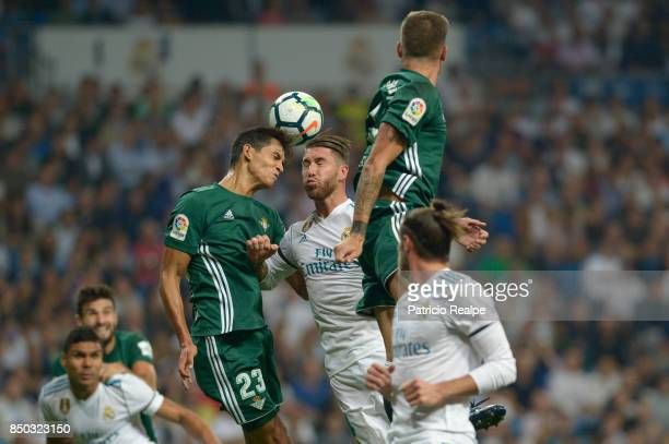 Sergio Ramos of Real Madrid struggles for the ball with Aïssa Mandi of Betis during a match between Real Madrid and Betis as part of La Liga at...
