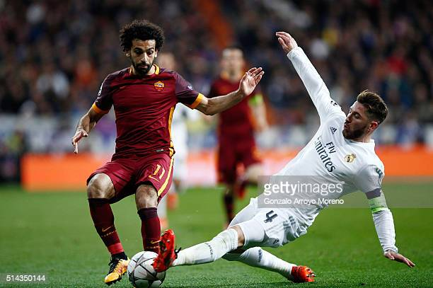 Sergio Ramos of Real Madrid tackles Mohamed Salah of Roma during the UEFA Champions League Round of 16 Second Leg match between Real Madrid and Roma...