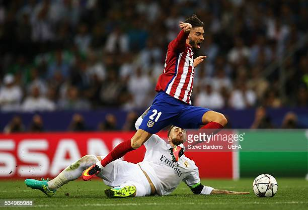 Sergio Ramos of Real Madrid tackles Yannick Carrasco of Atletico Madrid during the UEFA Champions League Final between Real Madrid and Club Atletico...