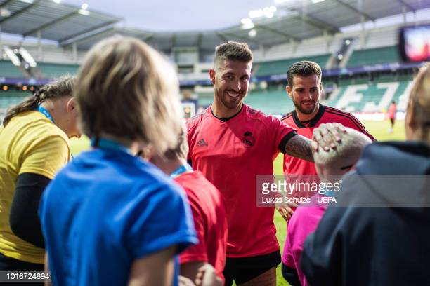 TALLINN ESTONIA AUGUST Sergio Ramos of Real Madrid talks to blind kids of the UEFA Foundation after Real Madrid's training session ahead of the UEFA...