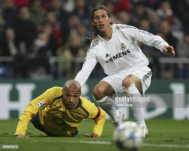 Sergio Ramos of Real Madrid watches the ball with Thierry Henry of Arsenal during a UEFA Champions League match between Real Madrid and Arsenal at...