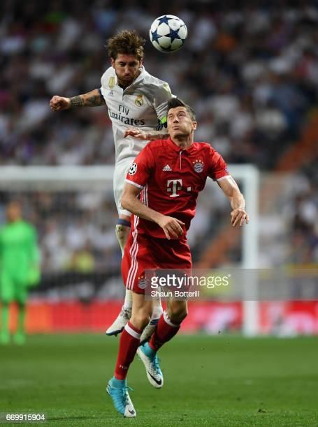 Sergio Ramos of Real Madrid wins a header over Robert Lewandowski of Bayern Muenchen during the UEFA Champions League Quarter Final second leg match...