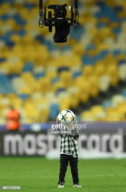 Sergio Ramos of Real Madrid's son shows the Spider Cam a matchball after a Real Madrid training session ahead of the UEFA Champions League Final...