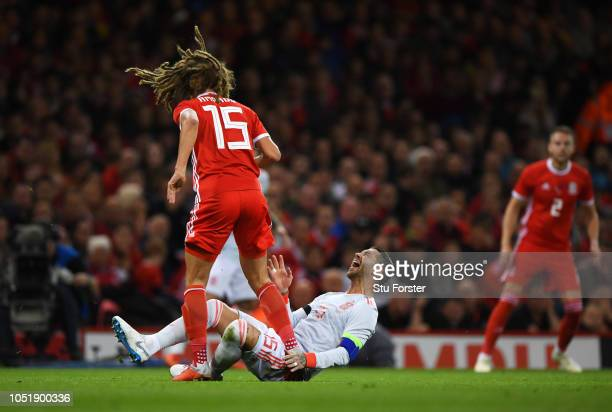 Sergio Ramos of Spain and Ethan Ampadu of Wales clash during the International Friendly match between Wales and Spain on October 11 2018 in Cardiff...