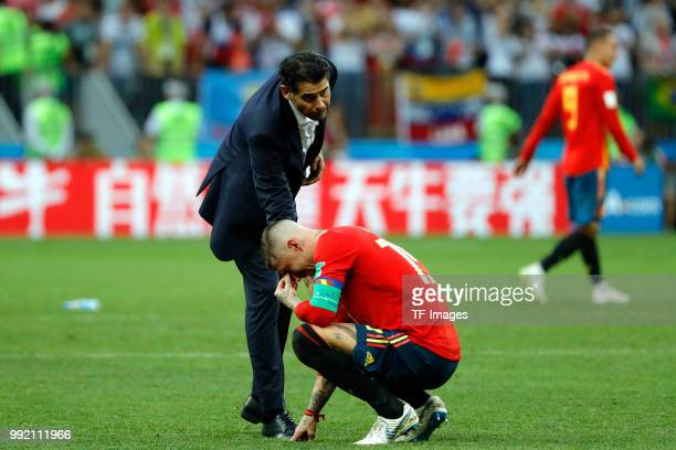 Sergio Ramos of Spain and Head coach Fernando Hierro of Spain look dejected after the 2018 FIFA World Cup Russia match between Spain and Russia at...
