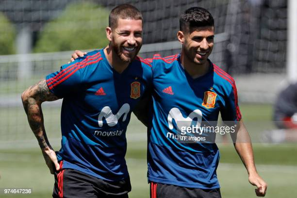 Sergio Ramos of Spain and Marco Asensio of Spain laugh during a training session on June 11 2018 in Krasnodar Russia