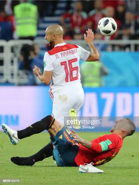 Sergio Ramos of Spain and Noureddine Amrabat of Morocco compete for the ball during the 2018 FIFA World Cup Russia group B match between Spain and...