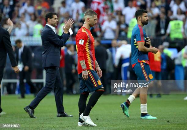 Sergio Ramos of Spain between coach Fernando Hierro and Diego Costa following the 2018 FIFA World Cup Russia Round of 16 match between Spain and...