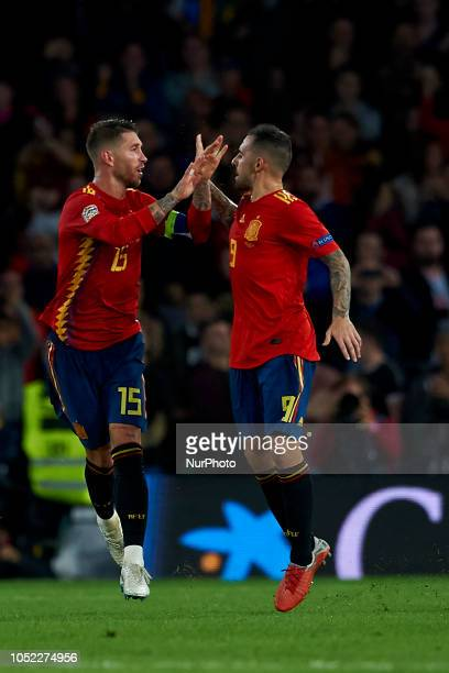 Sergio Ramos of Spain celebrates after scoring his sides first goal whit Paco Alcacer during the UEFA Nations League football match between Spain and...