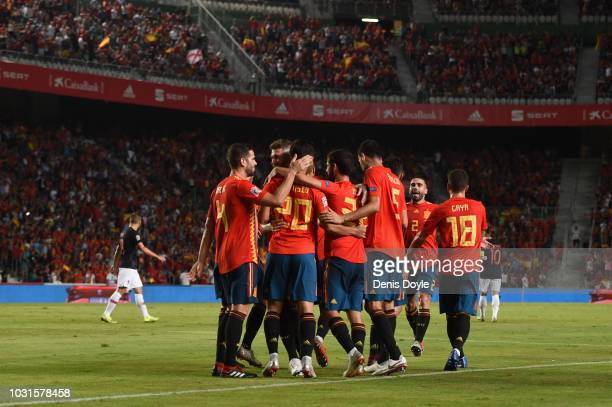 Sergio Ramos of Spain celebrates after scoring his team's fifth goal with team mates during the UEFA Nations League A Group four match between Spain...