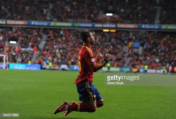 Sergio Ramos of Spain celebrates after scoring Spain's opening goal during the FIFA 2014 World Cup Qualifier between Spain and Finland at estadio El...
