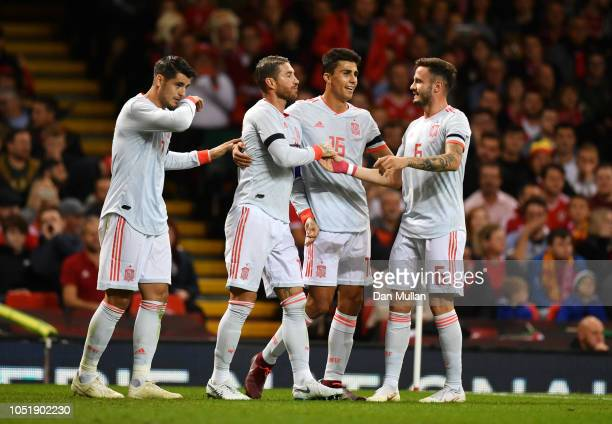 Sergio Ramos of Spain celebrates as he scores his team's second goal with team mates during the International Friendly match between Wales and Spain...